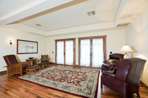 living room with area rug - how to soundproof a floor