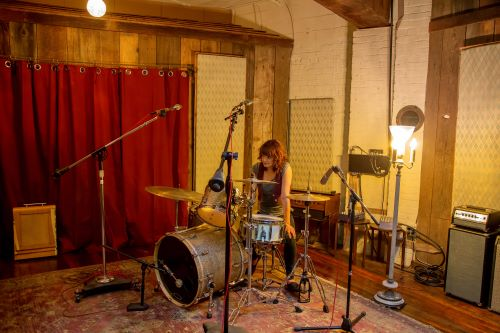 girl in drum room