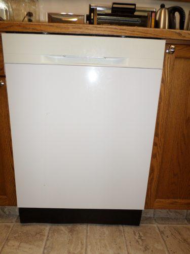 White dishwasher under cabinet
