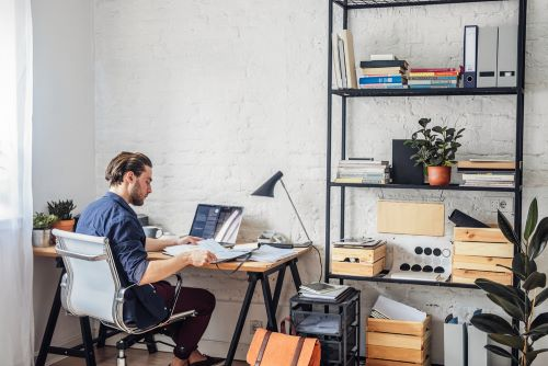 man working in home office