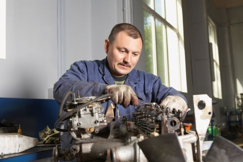 mechanic working on engine lifters