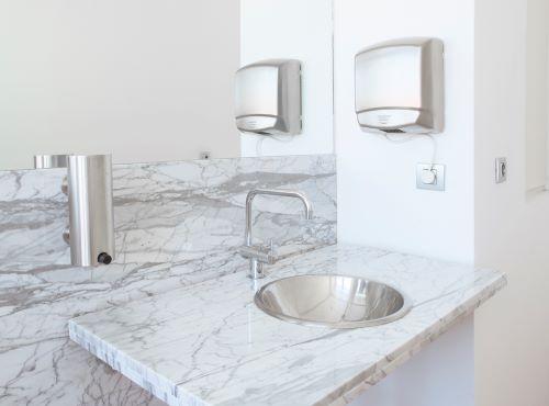 aluminum hand dryer in bathroom
