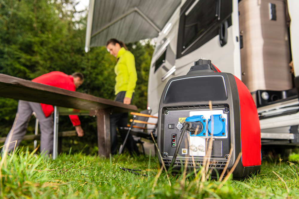 Gasoline generator power an RV, man woman out frong