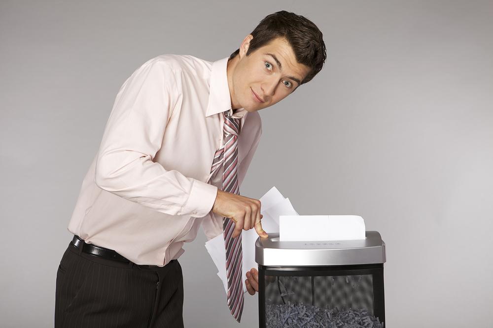 Guy listening to a quiet paper shredder